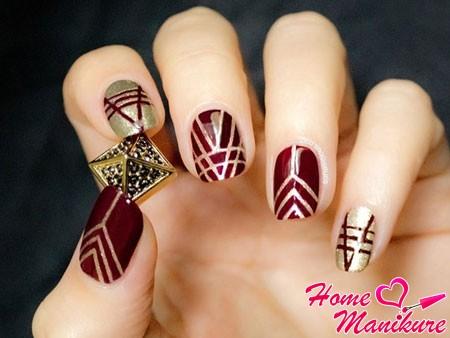 бордово-золотой рисунок на ногтях