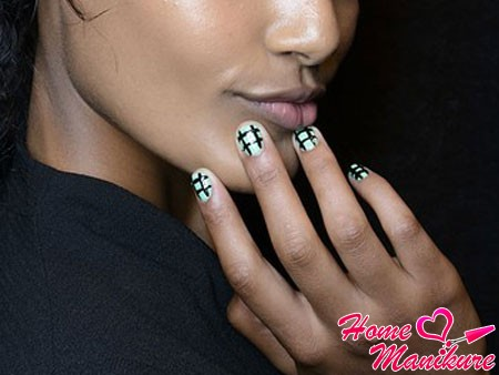 black grille on light green nails