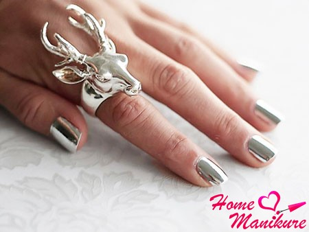 trendy Minx manicure with silver sheen