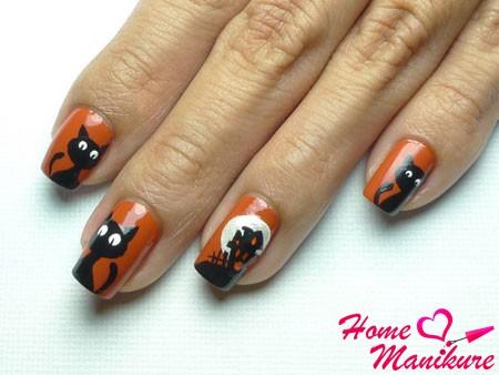 красивый дизайн ногтей с черными кошками