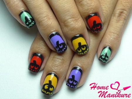 маникюр с разноцветными тыквами на ногтях