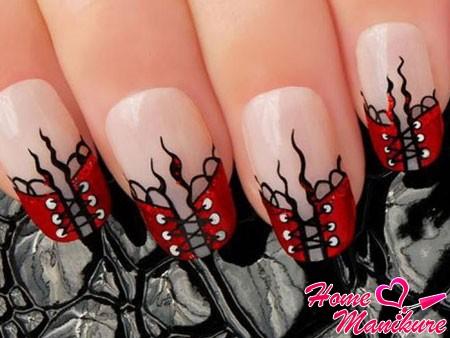 дизайн ногтей с сексуальными красными корсетами
