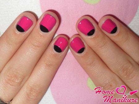 black and pink moon manicure on nails rounded