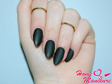 matt black manicure on nails almond