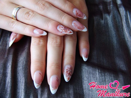 elegant french on the nails in the form of almond