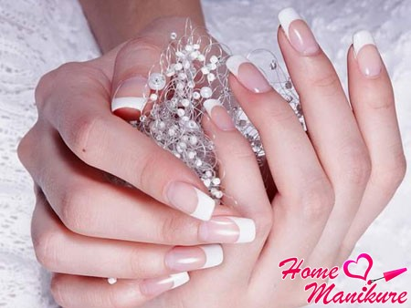 soft square on the nails of the bride