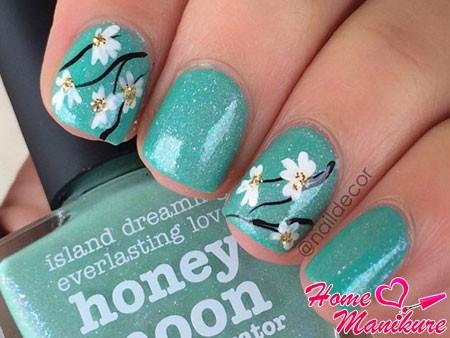 цветочные рисунки на бирюзовых ногтях